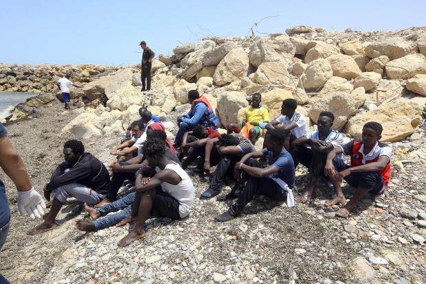 The surviving migrants. Photo: AFP