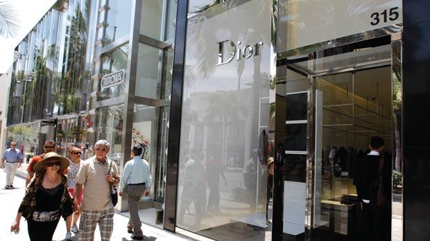 People walking past the Dior store on Rodeo Drive in Beverly Hills, California. Photos: Reuters