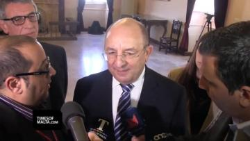 While the police commissioner made a quick exit, minister Michael Farrugia spoke with reporters. Video: Elisa Lemarchand