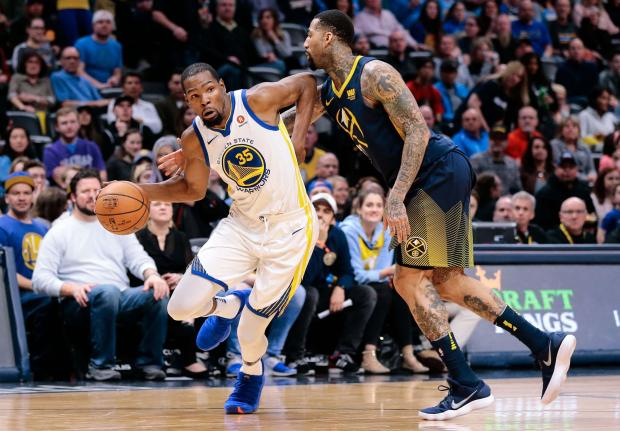 Denver Nuggets forward Wilson Chandler (21) fouls Golden State Warriors forward Kevin Durant (35) in the third quarter at the Pepsi Center. Photo Credit: Isaiah J. Downing-USA TODAY Sports