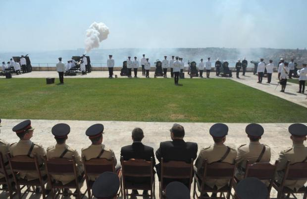 Members of the military watch as the 25-pound gun is fired to mark the 300th anniversary of the Royal Regiment of Artillery at the Upper Barrakka, in Valletta on July 10. Photo: Matthew Mirabelli