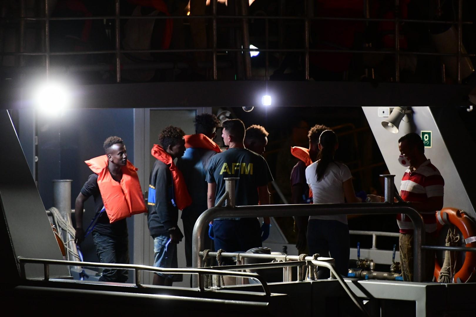 Some of the migrants disembarking in Malta on Sunday night. Photo: Jonathan Borg
