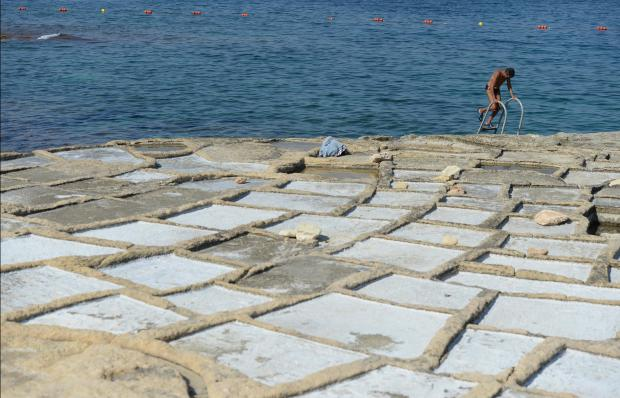 A man makes his way out of the water at the saltpans in Marsacala on August 29. Photo: Matthew Mirabelli