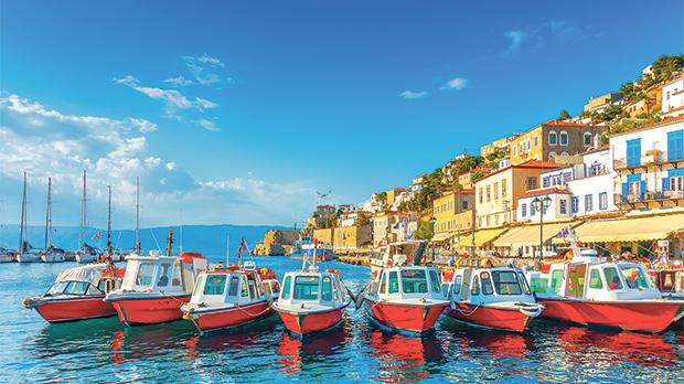 Traditional taxi boats in the port of Hydra island.