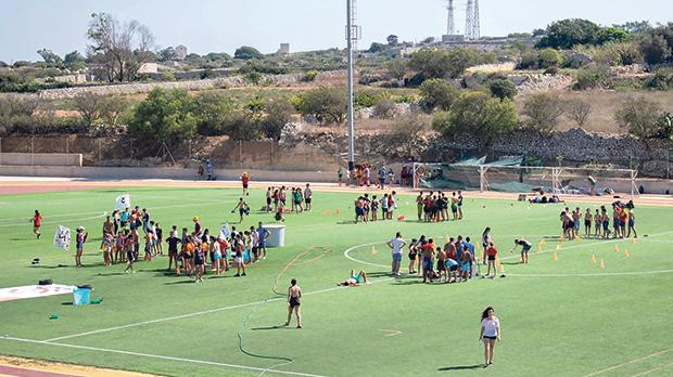 Some of the summer campers during outdoor activities at Savio College.