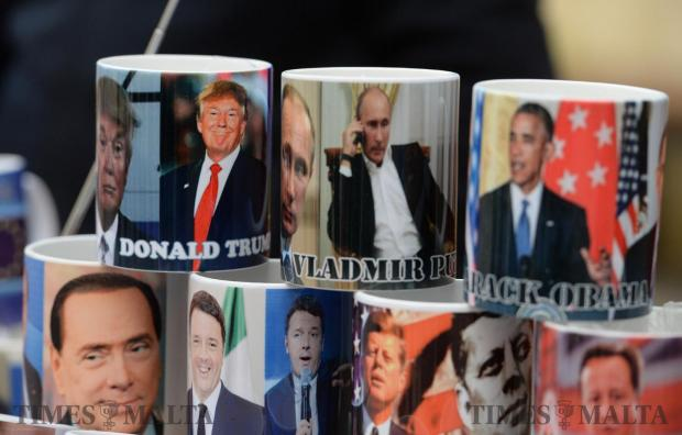 Newly sworn in US President Donald Trump takes his place on a mug in Valletta next to Russian president Vladimir Putin and former US President BarackObama. Photo: Matthew Mirabelli