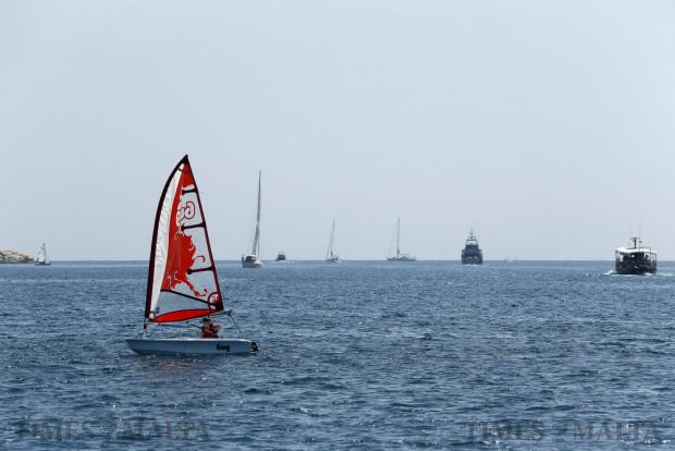 A young sailor navigates his sailing boat in Marsamxett Harbour on July 7. Photo: Darrin Zammit Lupi