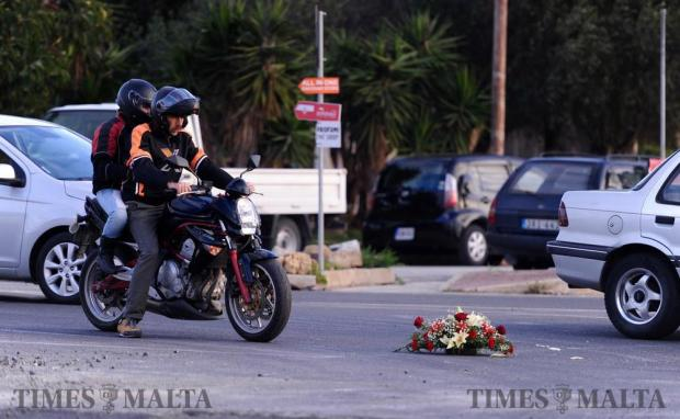 The parents of Johanna Boni, the 27-year-old women who was crushed by a truck on January 5 last year, return to the site of the accident a year later riding their daughter's repaired motorbike Photo: Steve Zammit Lupi