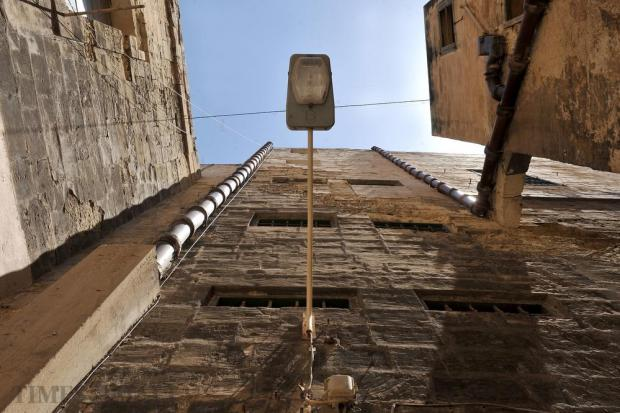 Drainage pipes and a street lamp attached to a building in a Valletta alley on May 18. Photo: Chris Sant Fournier