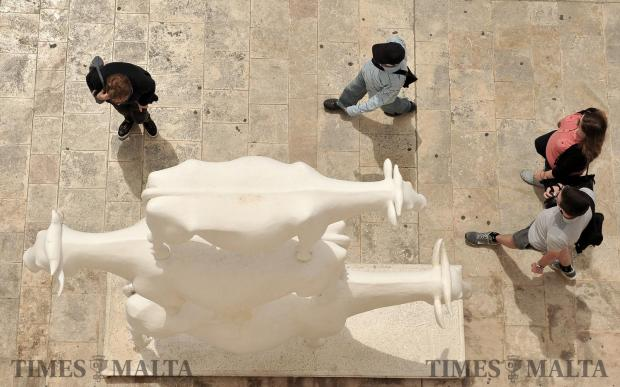 People walk past a sculpture in Valletta on May 17. Photo: Chris Sant Fournier