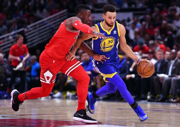 Golden State Warriors guard Stephen Curry (30) dribbles the ball against Chicago Bulls guard David Nwaba (11) during the second half at the United Center. Photo: Mike DiNovo-USA TODAY Sports