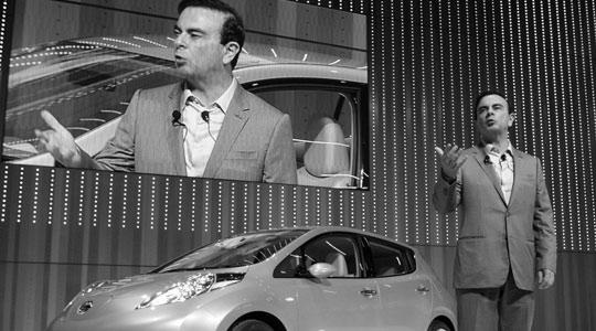 "Nissan Motor Co's chief executive officer Carlos Ghosn introducing the company's prototype of the first mass-volume electric car ""Leaf"" during an opening ceremony at the company's new global headquarters in Yokohama, south of Tokyo, Japan yesterday."