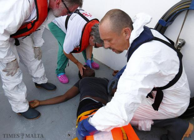 Medecins san Frontiere (MSF) medics examine a semi-conscious migrant who was brought onto the Migrant Offshore Aid Station (MOAS) ship MV Phoenix some 32 kilometres off the coast of Libya on August 3. 118 migrants were rescued from a rubber dinghy off Libya on Monday morning. The Phoenix, manned by personnel from international non-governmental organisations MSF and MOAS, is the first privately funded vessel to operate in the Mediterranean. Photo: Darrin Zammit Lupi