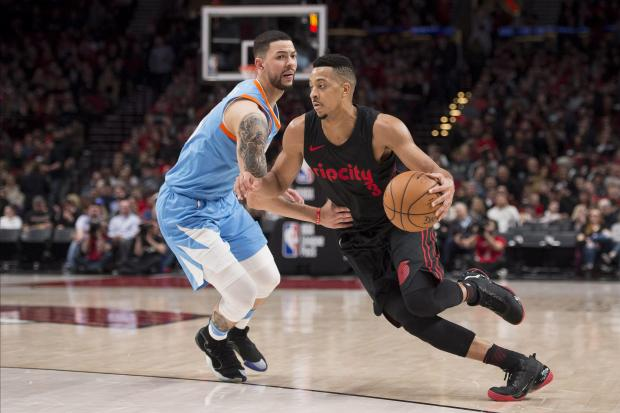 Portland Trail Blazers guard CJ McCollum (3) drives against LA Clippers guard Austin Rivers (25) during the second half at the Moda Center. Photo Credit: Troy Wayrynen-USA TODAY Sports