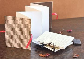 Concertina book with patterned cover and ribbon closure on both sides.