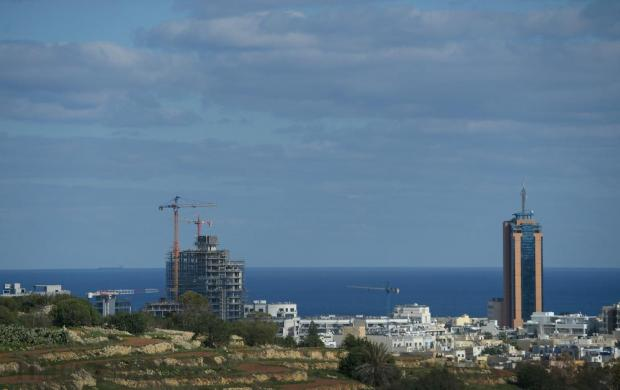 The changing skyline of St Julian's as seen from San Gwann with a new tower slowly making its way onto the horizon on December 2. Photo: Matthew Mirabelli