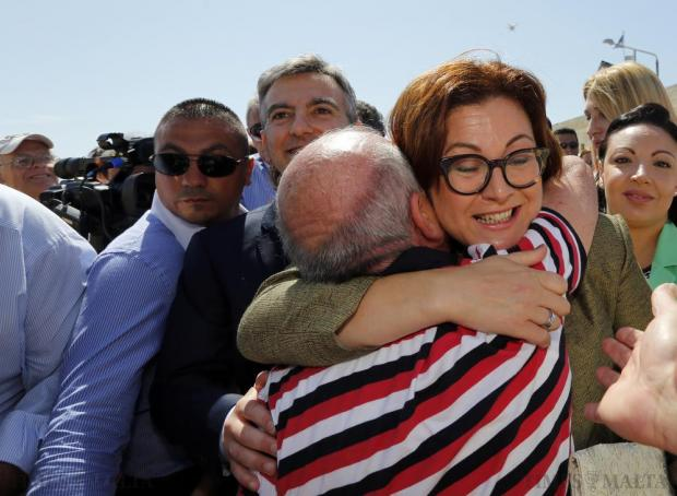 Government and Labour MP Marlene Farrugia is embraced as she walks into a Nationalist Party rally at Zonqor Point on May 31. Photo: Darrin Zammit Lupi