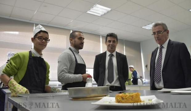 Education Minister Evarist Bartolo looks at a plated dish prepared by home economics students at the Maria Regina Secondary School in Mosta on December 6. Photo: Mark Zammit Cordina