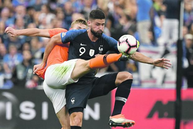 Olivier Giroud tries to control the ball against the Netherlands.