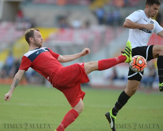 Pembroke Athleta's Paltemio Barbetti (left) and Hibernians Bjorn Kristensen vie for the ball at the National Stadium in Ta'Qali on September 17. Hibs came back from a goal down to win 2-1. Photo: Matthew Mirabelli