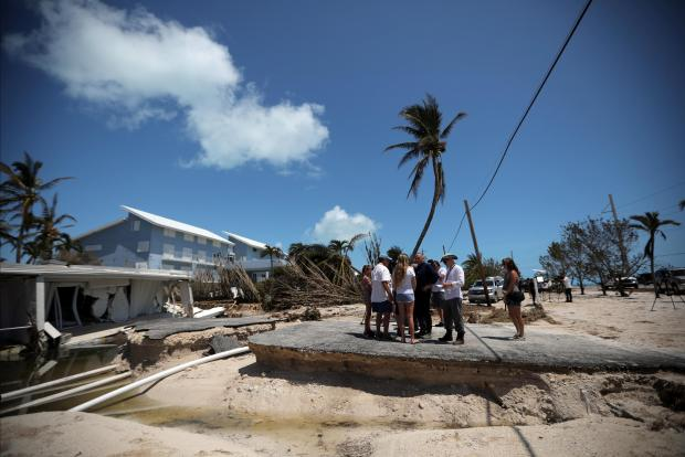 Local residents stand by a destroyed house after Hurricane Irma struck Islamorada, Florida. Photo: Reuters