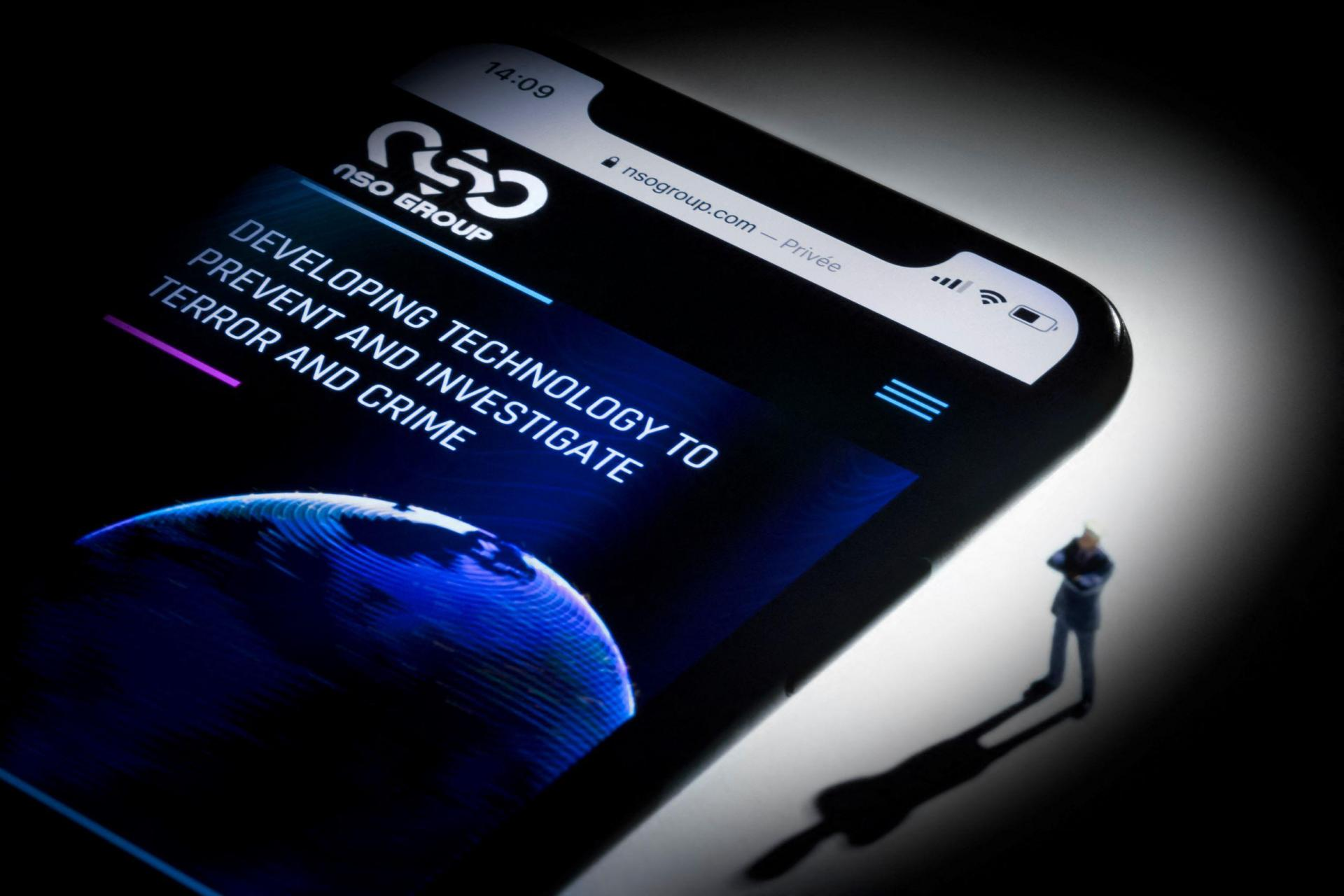 This studio photographic illustration shows a smartphone with the website of Israel's NSO Group which features 'Pegasus' spyware, on display in Paris, for which Apple issued an urgent fix. Photo: Joel Saget/AFP