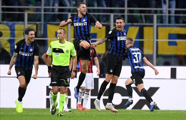 Inter players celebrate their derby win versus Milan
