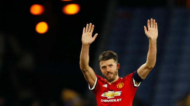 Manchester United's Michael Carrick gestures to fans after the match.