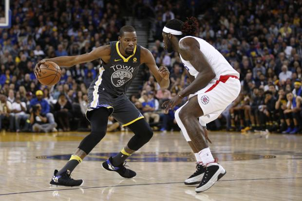 Golden State Warriors forward Kevin Durant (35) dribbles the ball against the Los Angeles Clippers in the third quarter at Oracle Arena. Photo Credit: Cary Edmondson-USA TODAY Sports