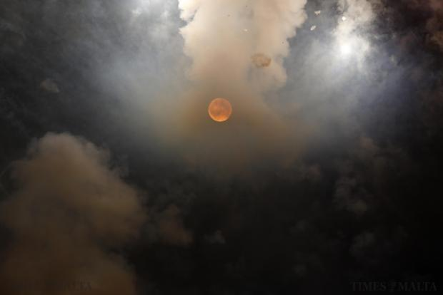 Smoke from fireworks partly obscures the supermoon on the outskirts of Mosta on August 10, celebrating the feast Our Lady of the Assumption which is commemorated on August 15. The astronomical event occurs when the moon is closest to the Earth in its orbit, making it appear much larger and brighter than usual. Photo: Darrin Zammit Lupi