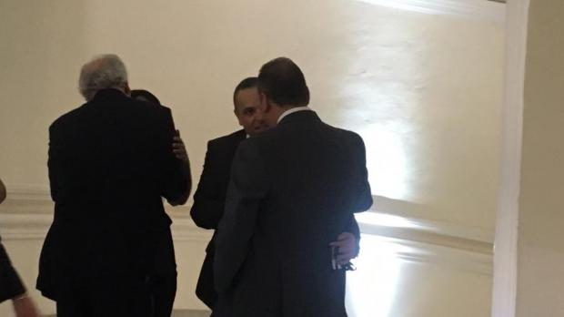 Keith Schembri can be seen walking up the Palace stairs. Photo: Ivan Martin
