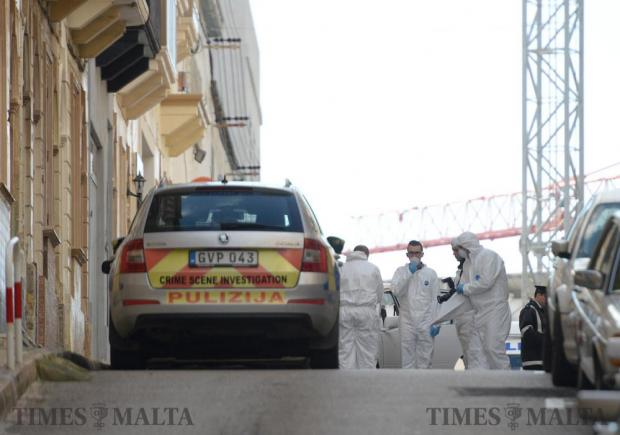 Members of the Forensic department gather evidence at the scene of a suspected shooting in Marsa on February 12. Photo: Matthew Mirabelli