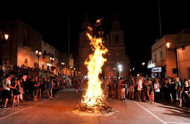 People watch the St John Bonfire in the Mellieha Square on June 20. Photo: Chris Sant Fournier