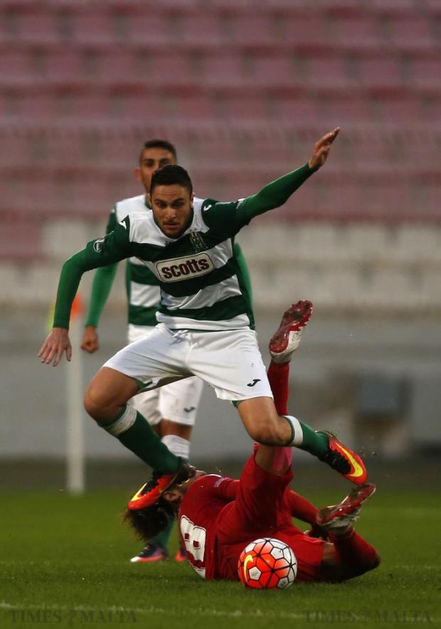 Floriana's Clyde Borg jumps over Valletta's Valdo Alhinho during their Premier League football match at the National Stadium in Ta'Qali on December 17. Photo: Darrin Zammit Lupi