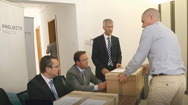 The bids for the €2 billion concession were unsealed in May 2015 under the supervision of Projects Malta board secretary Aaron Mifsud Bonnici (second from right), Tourism Minister Konrad Mizzi's personal lawyer.