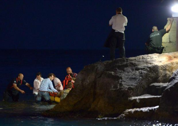 Emergency responders work frantically to bring an injured person on board a rescue vessel after a balcony collapsed at the Barracuda Restaurant in Balluta Bay on May 16, throwing a number of patrons into the sea. Photo: Matthew Mirabelli