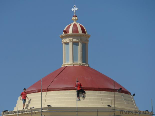 Two workers apply the finishing touches to the cupola of the parish church of Gharghur on August 10, dedicated to Bartholomew in preparation for the upcoming village feast. Photo: Matthew Mirabelli
