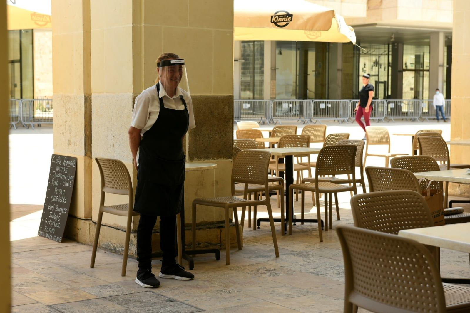A waiter waits for customers at a restaurant Valletta on Friday PHOTO: Chris Sant Fournier