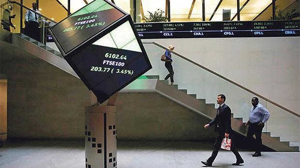 The lobby of the London Stock Exchange. Photo: Suzanne Plunkett/Reuters