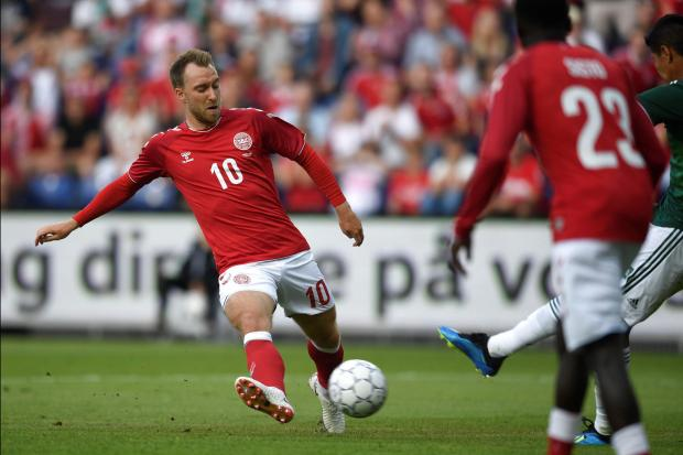 Christian Eriksen shoots at goal against Mexico.