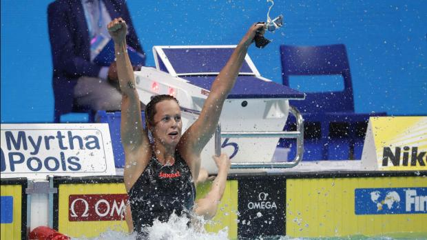 Ledecky breezes to 3rd worlds gold, brash King wins again