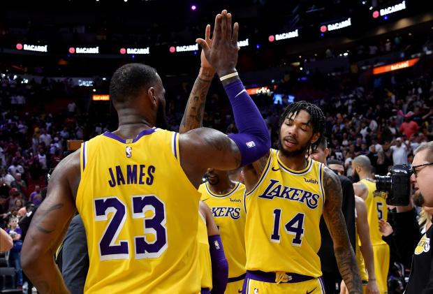 Los Angeles Lakers forward LeBron James (left) celebrates their win with Lakers forward Brandon Ingram (right) against the Miami Heat at American Airlines Arena. Mandatory Credit: Steve Mitchell-USA TODAY Sports