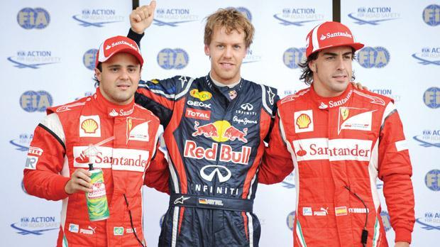 Sebastian Vettel with Fernando Alonso (right) and Felipe Massa, whom he might replace at Ferrari.