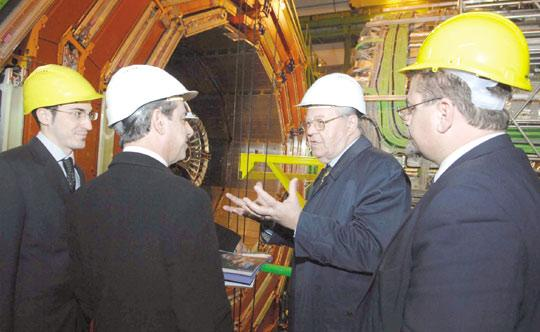 CERN director general Robert Aymar explaining how the CMS (compact muon solenoid), one of the detectors of the LHC (large hadron collider), works. From left: CERN scientist Nicholas Sammut, Prime Minister Lawrence Gonzi and University rector Juanito Camilleri.