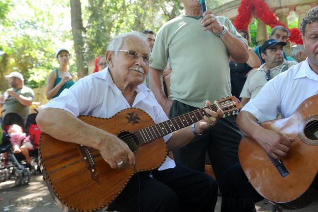 A guitarist plays during the traditional folk singing competition during the L-Imnarja feast in Buskett on June 29. Photo: Steve Zammit Lupi