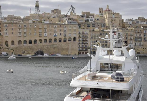 A small sailing boat and car are seen on the helicopter deck of a luxury yacht in Vittoriosa. on November 23. Photo: Mark Zammit Cordina.