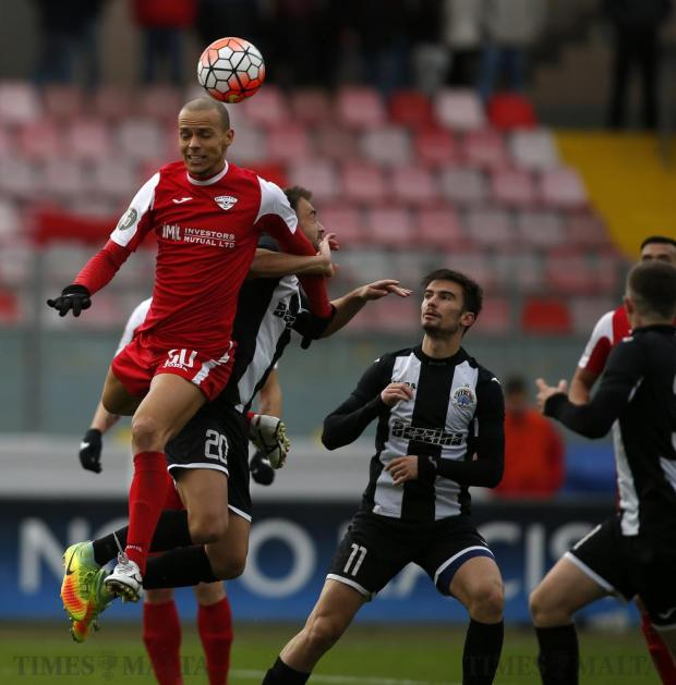 Balzan's Bruno and Hibernians' Andrei Agius challenge for a high ball as Hibernians' Bjorn Kristensen looks on during their Premier League football match at the National Stadium in Ta'Qali on December 17. Photo: Darrin Zammit Lupi