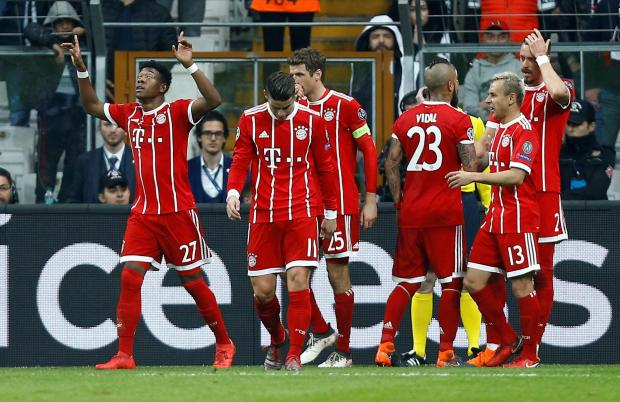 Bayern Munich's Sandro Wagner celebrates with team mates after scoring their third goal.