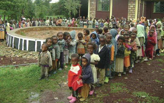 Ethiopian children from families with leprosy line up outside the school built for them by the movement.