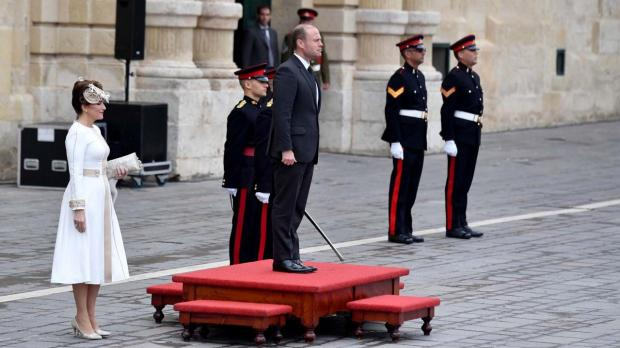Prime Minister Joseph Muscat is greeted outside the Palace, with Mrs Muscat (left).